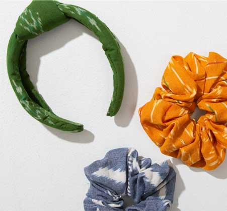 The green Lush Headband and orange and blue Ikat Scrunchies.