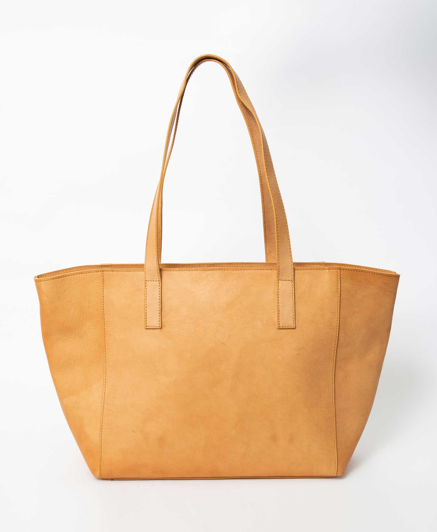 The City Tote is unzipped and its interior is shown. It features a solid black fabric lining. One of the bag's interior zipper pockets can be seen. Just below the pocket's zipper is a leather patch with